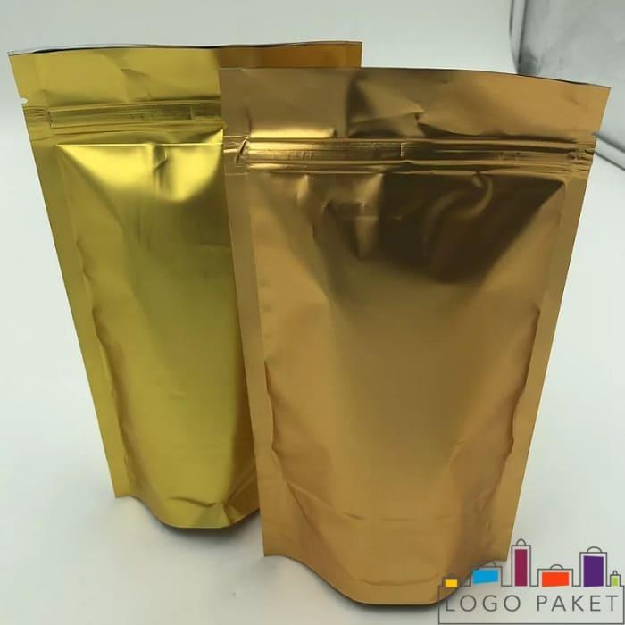 Фото двух пакетов дой пак металлизированных золотой фольгой двухшовных с центральным швом