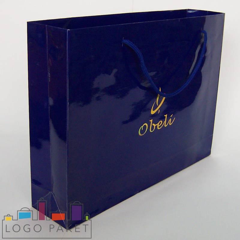 пакет с ручками из мелованной бумаги синий